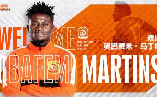 Obafemi Martins Receives Graphic Welcome On Arrival At Wuhan Of China